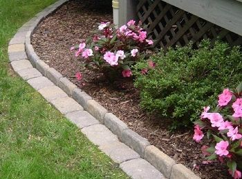 Diy brick edging for your flower beds home landscaping for Diy flower bed edging ideas