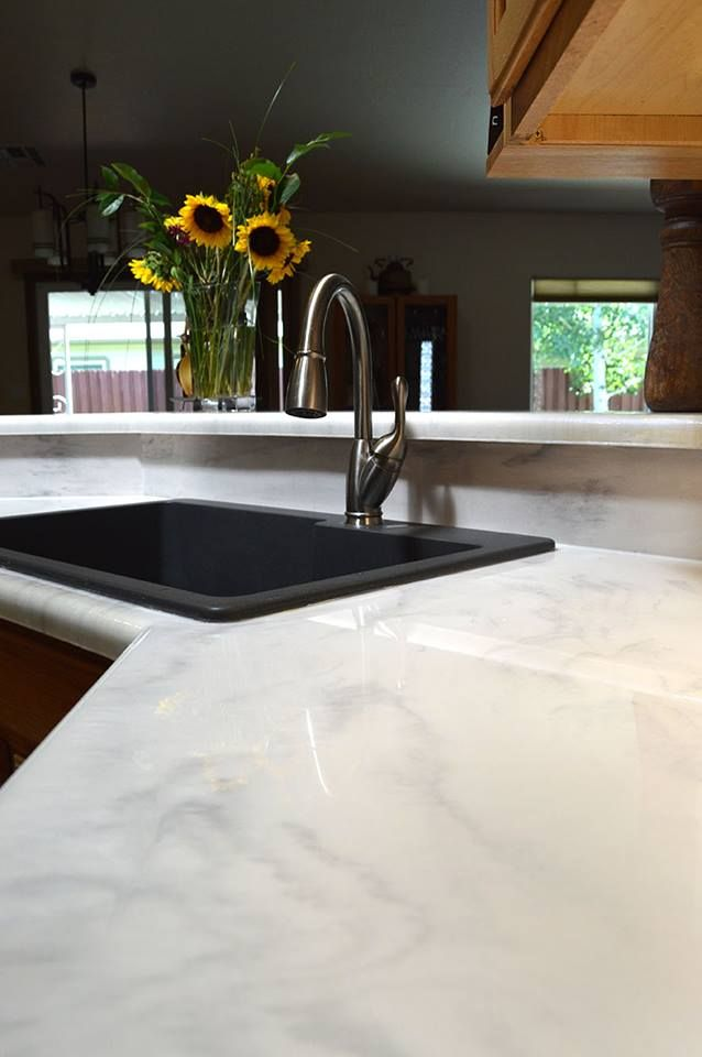 Get a custom white marble look out of your kitchen countertops! Epoxy countertops are significantly more durable and only a fraction of the cost of actual marble!
