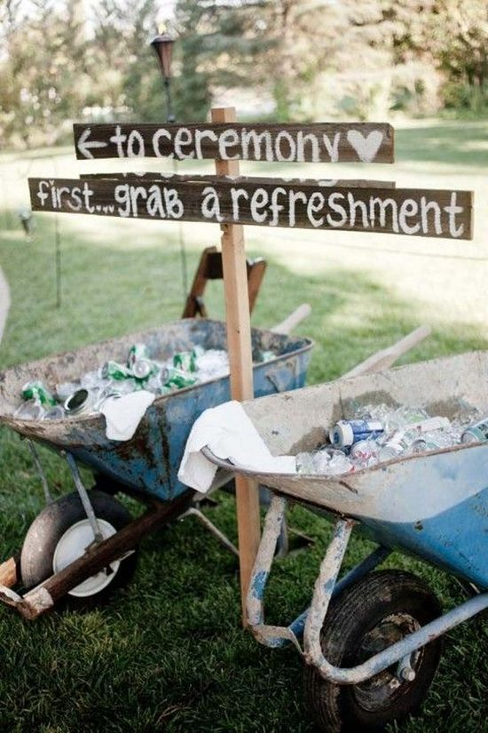 Old wheelbarrow, some wood and paint and you have a 'help yourself' bar!