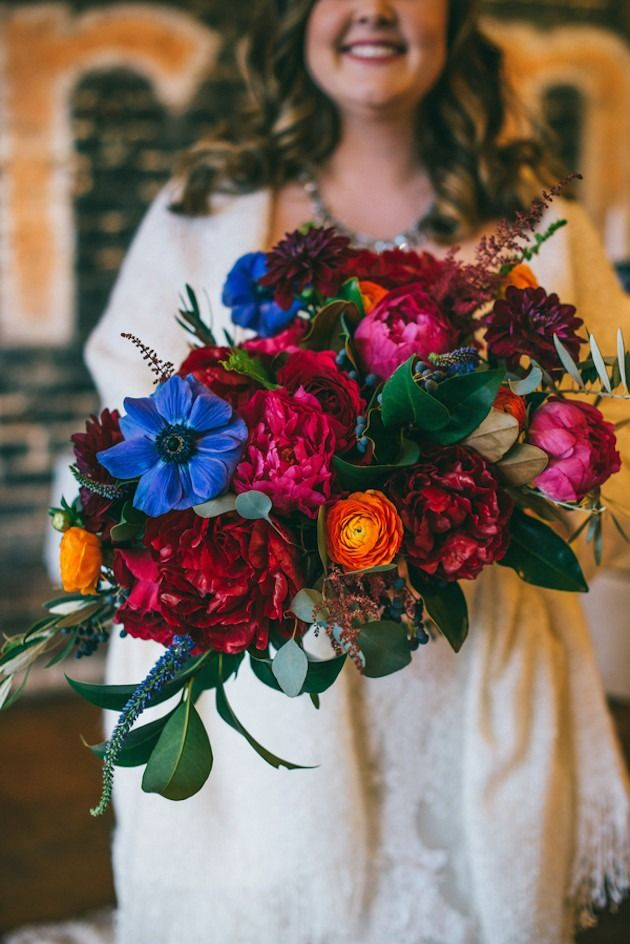 Brighten your winter wedding with a vibrant bouquet of flowers.