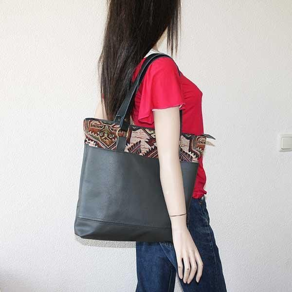 Eco friendly handmade leather bag from upcycled leather. A sofa gets a new life!