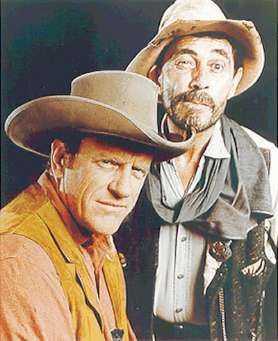 Ken Curtis (right) who portrayed the squinty-eyed deputy Festus Haggen on the long running tv western Gunsmoke from 1964-1975, helped keep law and order in Dodge City along with James Arness who played Marshal Matt Dillon.