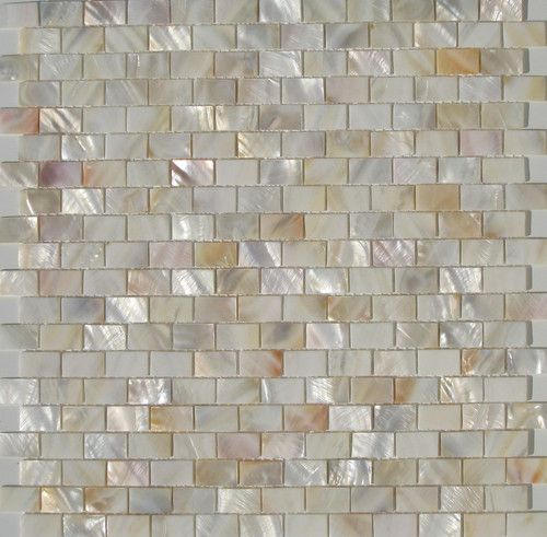 Love the mother-of-pearl backsplash tile!! Thinking about surrounding the bathroom vanity with this backsplash....