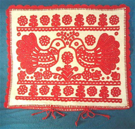 red embroidered pillow case from Kalotaszeg