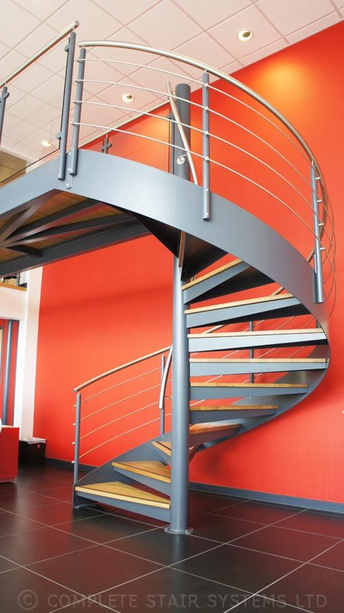 This is a commercial spiral staircase for a car showroom/office space