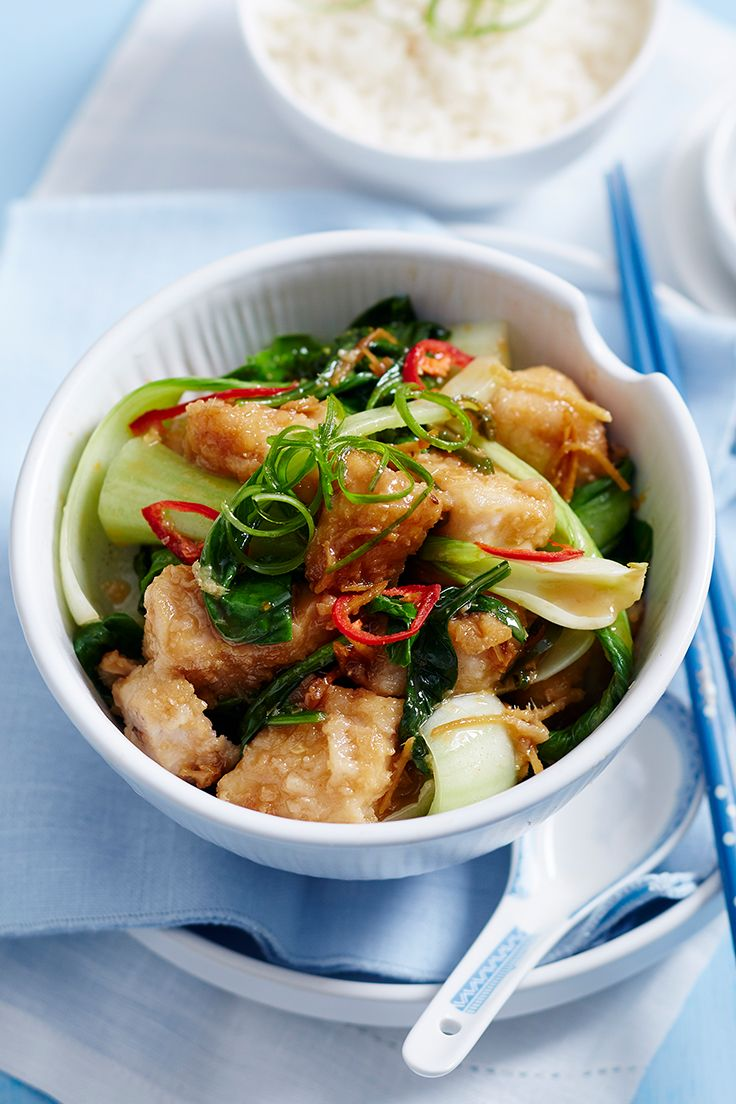 This fragrant fish stir-fry with wilted leafy greens and fluffy rice is perfect for quick midweek dinners.