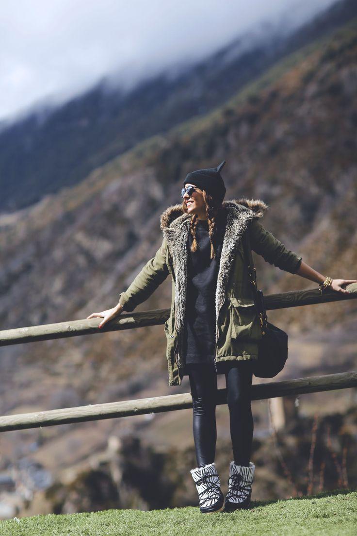 Trendy Taste – Positive Energy. Long black sweater+black leggins+winter boots+khaki parka+black hat+black shoulder bag. Winter outfit 2016