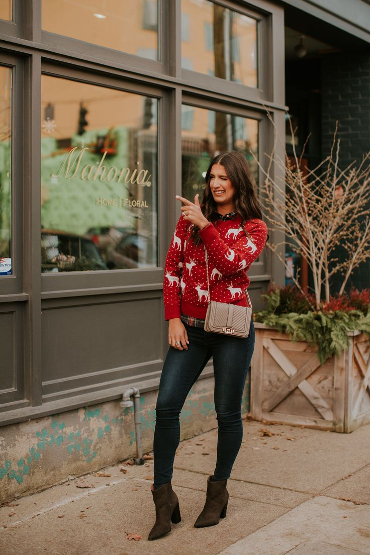 Plaid shirt+red christmas print sweater+dark skinny jeans+brown heeled ankle boots+beige chain shoulder bag. Christmas Casual Outfit 2017-2018