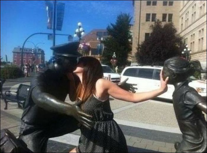30 people who saw a statue and took the opportunity to take and epic picture....I need to do this