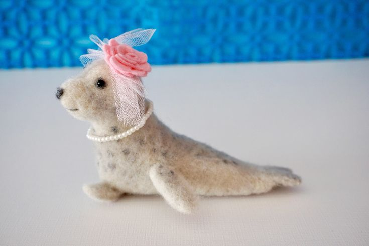 Needle felted leopard seal with fascinator hat and necklace by HestiasNest on Etsy https://www.etsy.com/listing/583031394/needle-felted-leopard-seal-with