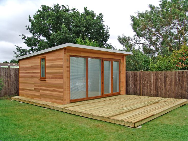 Garden studio with large decking area by garden lodges for Large garden studio