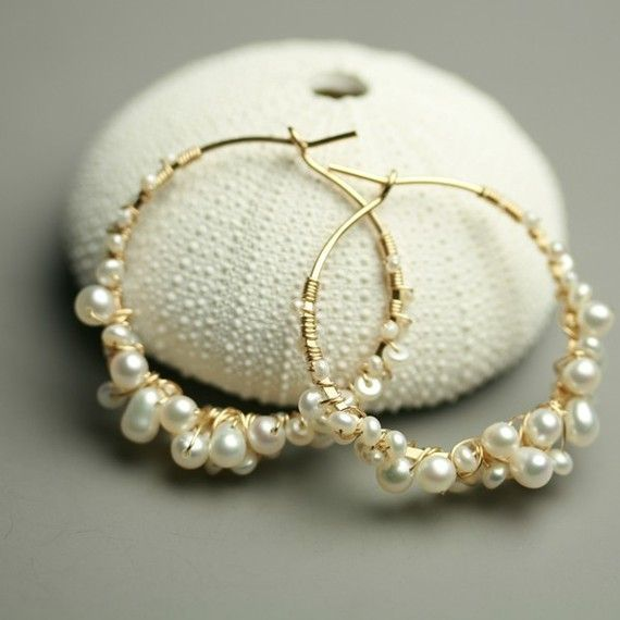 Ive shaped a one inch diameter hoop of gold fill wire and wrapped it with teensy pearls, tiny pearls and little pearls! These pearly best-sellers