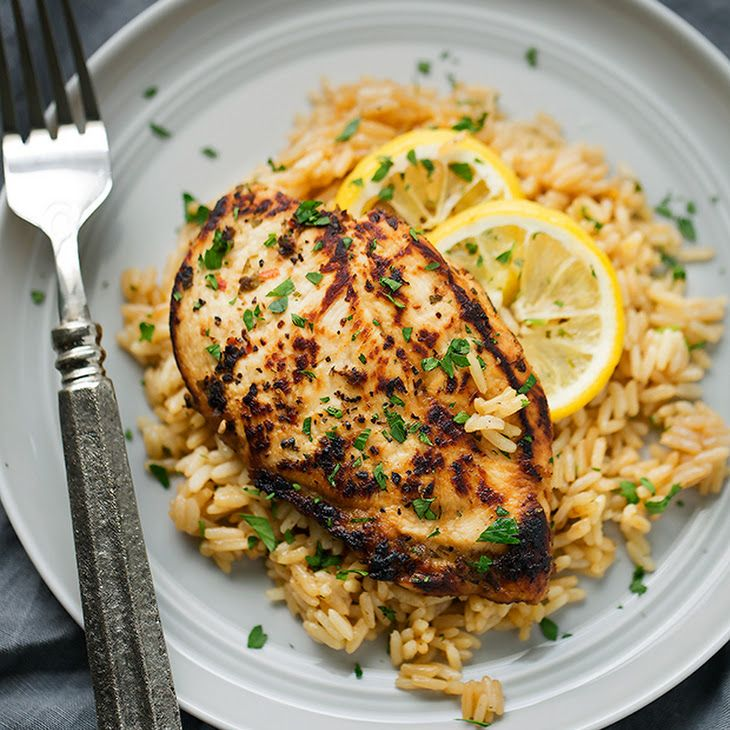 One Pot Greek Chicken and Rice Pilaf Recipe Main Dishes with boneless skinless chicken breasts, olive oil, red wine vinegar, minced garlic, salt, black pepper, red pepper flakes, fresh oregano, butter, parboiled rice, chicken broth, lemon juice, lemon, chopped parsley