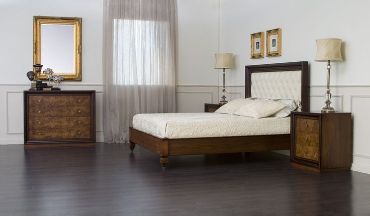 Prestige bed made by solid walnut wood. The headboard is upholstered with leather