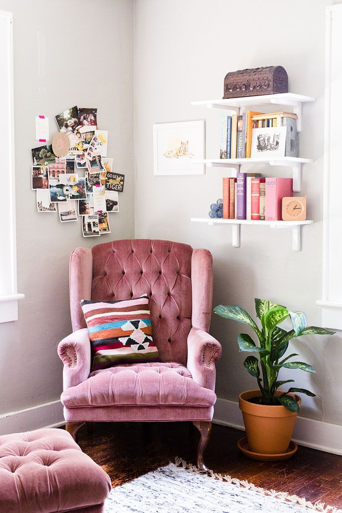 A cozy corner with a pink velvet armchair you just want to snuggle into with a good book.