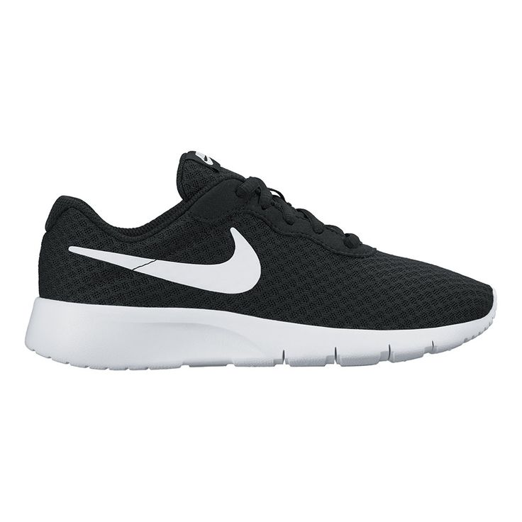 The Nike™ Kids' Tanjun GS Running Shoes feature textile uppers and IU  midsoles and outsoles.