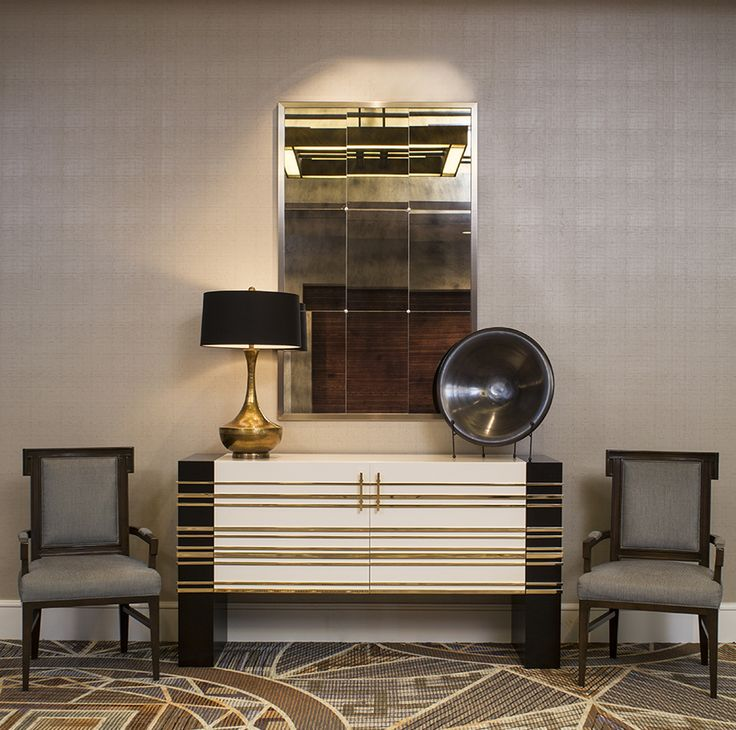 black and white credenza with gold detailing , upholstered armchairs. Gold lamp, antiqued mirror complete the vignette. by @SfaDesign, for more inspirations and ideas visit: http://www.bocadolobo.com/en/inspiration-and-ideas/