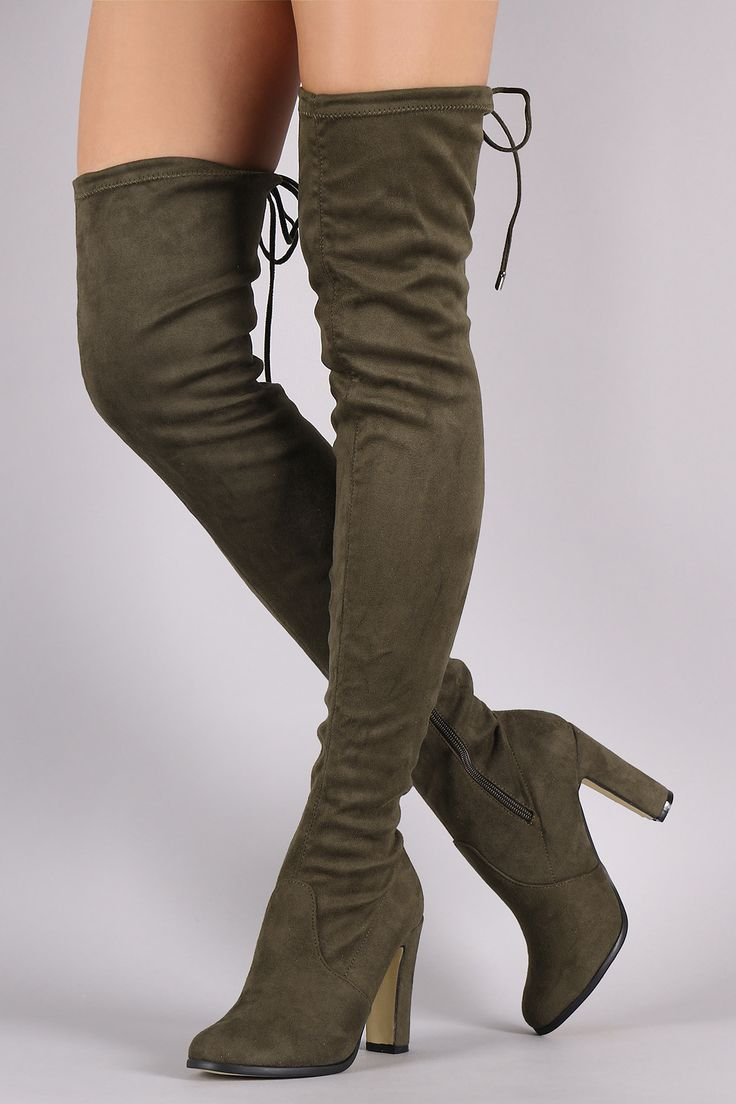Description These over-the-knee boot s features a soft vegan suede, thick wrapped heel, round toe, and a drawstring collar that ties at the back for custom fit. Finished with a partial side zipper clo
