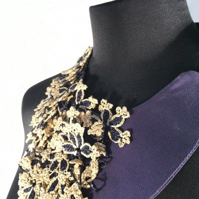 The LucaGallini necklace - Italian satin cut into a crescent moon, frames the neckline with royal purple. This piece is inspired by strange, but beautiful dreams. Hand crocheted golden flowers create an ornate and delicate necklace. #necklace #handmade