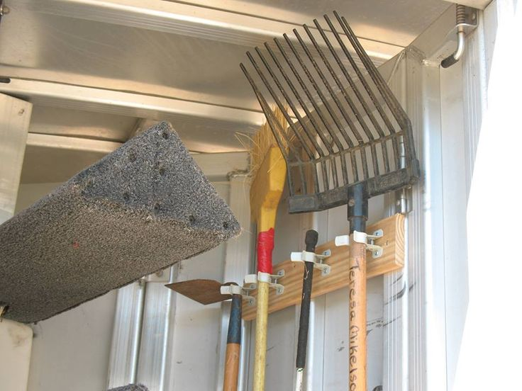 2x4 with spring clip to hold clean up essentials #horse trailer #trailer organization #tack room