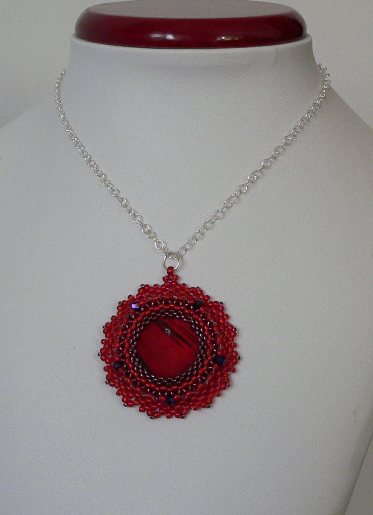Pendant made with nacre, fire polish, Toho seed beads of different sizes, colours and metal elements.  Zawieszka wykonana z masy perłowej, koralików fire polish, Toho w różnych kolorach i rozmiarach oraz elementów metalowych.