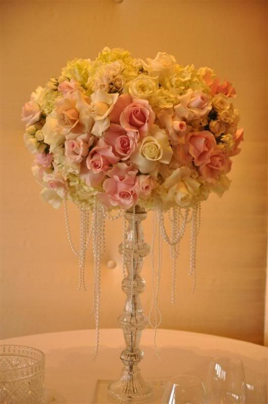 Hanging pearls and pink white reception wedding flowers