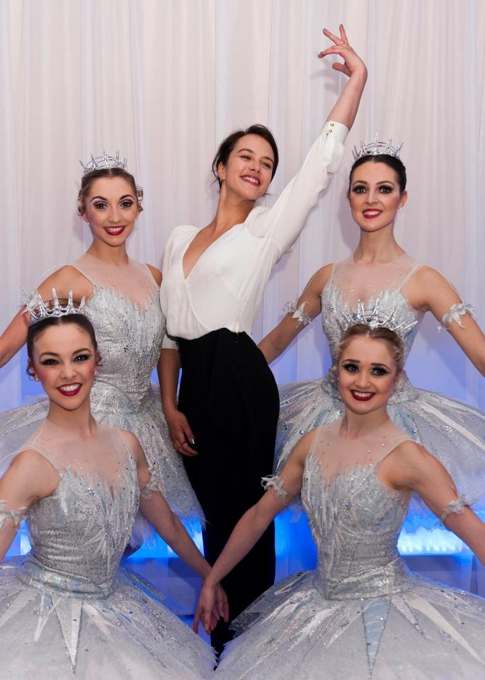 Former Downton Abbey star and former ballet dancer Jessica Brown Findlay poses with dancers backstage