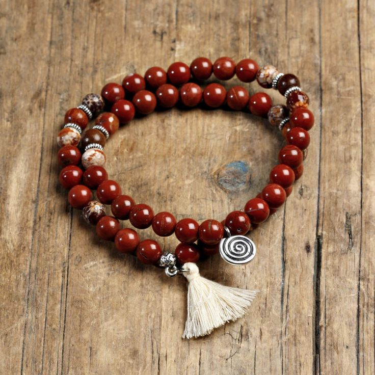 A personal favorite from my Etsy shop https://www.etsy.com/listing/267233401/striking-red-jasper-wrist-mala-with-red