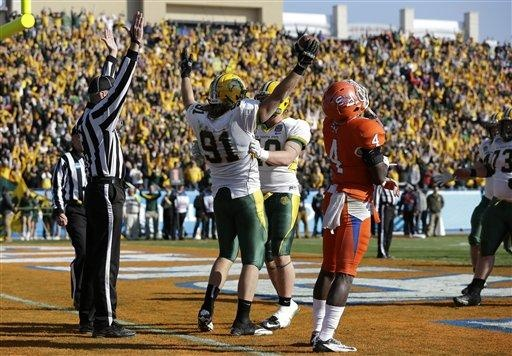 An official signals as North Dakota State's Mike Hardie (91) and Andrew Grothmann, center right, celebrate Hardie's catch on a two-point conversion that developed from a botched extra-point attempt in the second half of the FCS Championship NCAA college football game against Sam Houston State Saturday, Jan. 5, 2013, in Frisco, Texas. Sam Houston State's Bookie Sneed (4) reacts to the play in the 39-13 NDSU win.