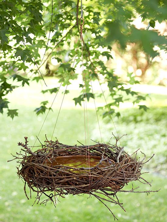 Ordinary grapevine wreath can give an interesting organic twist to a variety of garden elements, including a birdbath. Here, grapevine is twisted around a shallow ceramic bowl. Loops of copper wire suspend the birdbath from a branch. Twigs tucked in here and there add to the natural look.