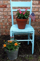 old chair bought at goodwill and spray painted (two layers)... sits in my garden with pots of flowers.  Easy way to add a splash of color to garden, yard or porch.