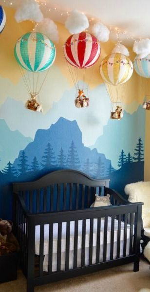 It's amazing what paper lanterns can become! This DIY hot air balloon garland adds a beautiful, whimsical style to this boy's nursery room. Along with a mountain mural, this sweet bedroom is like no other.