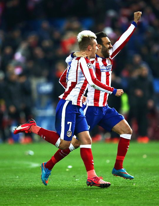 Antoine Griezmann and Jesus Gamez of Atletico Madrid