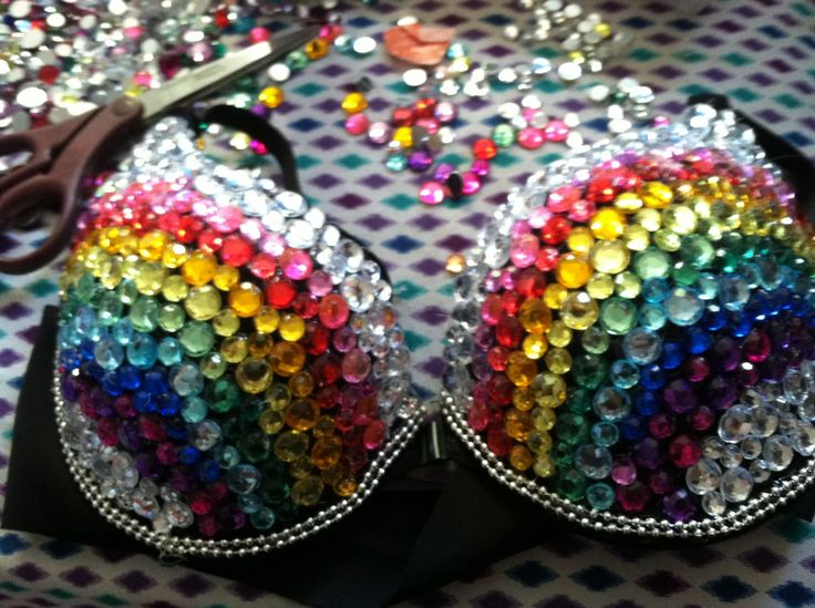DIY rainbow bedazzled bra: All you need is a hot glue gun, a bra of your choice and a bag of colorful rhinestones/gems.