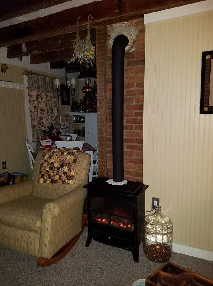 I finally found a way to satisfy my longing for a woodstove in our very small house. We've had this electric woodstove for many years. Last week we bought a section of 6 inch PVC pipe and an elbow,  painted it black and set it on top of the stove in front of the chimney. So happy with the results!