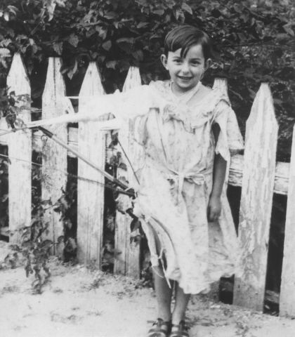 Date:	1939  Locale:	Poland  Credit:	United States Holocaust Memorial Museum, courtesy of Shulamith Garbasz-Zimet  Copyright:	United States Holocaust Memorial Museum    A young Jewish girl poses by a garden fence.    Pictured is Chaja Garbasz, who later perished in the Holocaust.