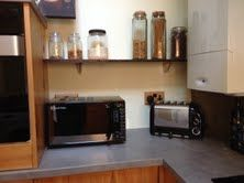 48) Fully in use and the kitchen is being enjoyed and loved as well as being worked in.