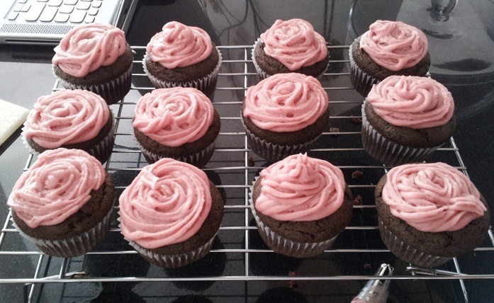 All-Natural Strawberry Coconut Frosting...made with coconut oil for the butter and strawberry jam for the red food colouring!