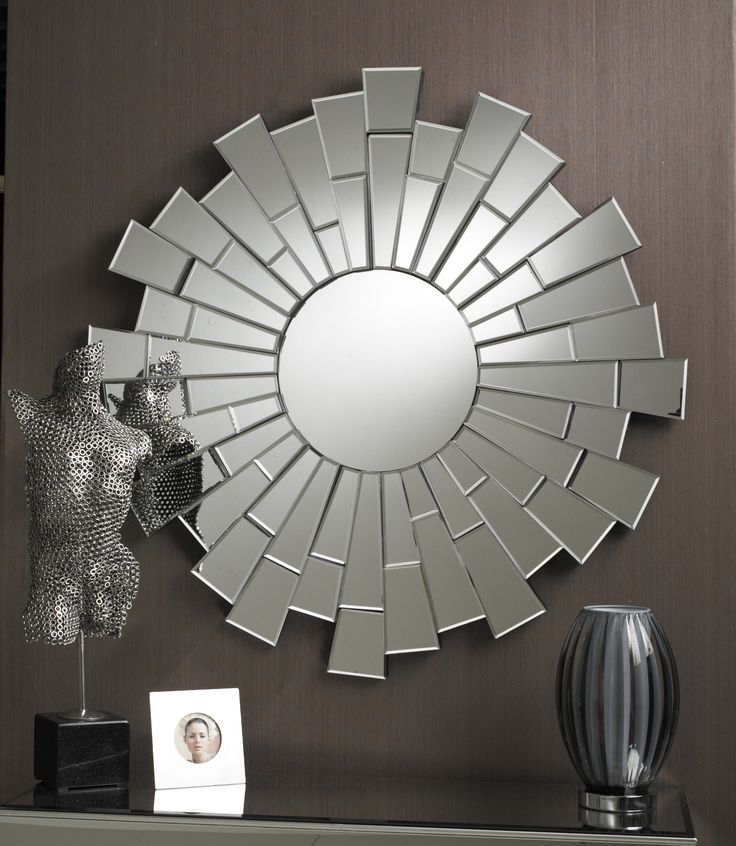 This is a stylish Art Deco influenced mirror: it features a small round central piece with multifacet shattered pieces shoooting out like starburst rays, giving a bold 3D effect. It makes a dramatic talking point for any contemporary room.