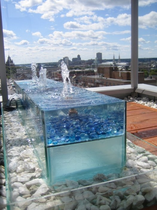 17 best images about fountains on pinterest wall for Decorative pond fish crossword