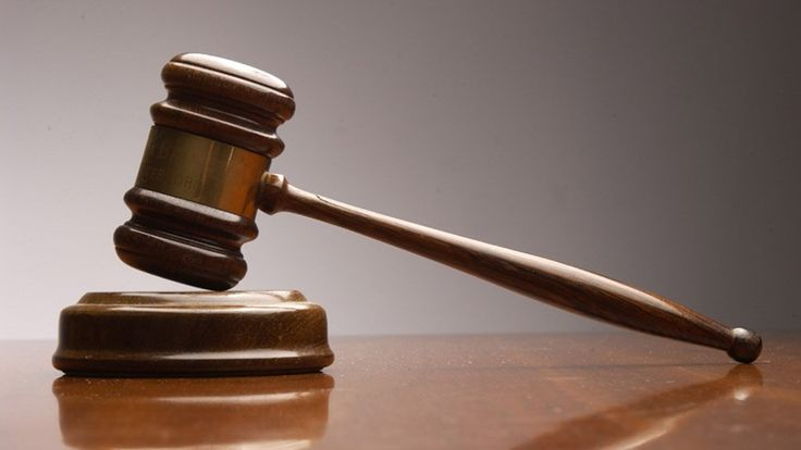 South African top court says law on land claims invalid.