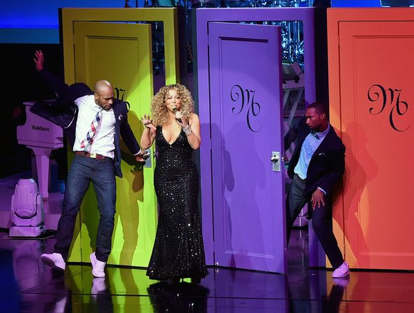 """Mariah Carey Photos - Singer/songwriter Mariah Carey (C) performs with dancers during the launch of her residency """"MARIAH #1 TO INFINITY"""" at The Colosseum at Caesars Palace on May 6, 2015 in Las Vegas, Nevada. - Mariah Carey Launches 'MARIAH #1 TO INFINITY' At Caesars Palace In Las Vegas"""