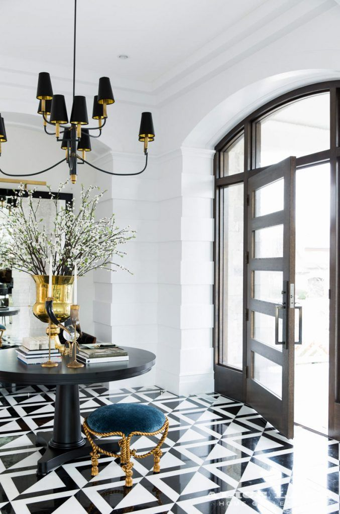 Stunning entryway featuring black white and gold