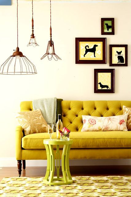 Brave vintage design! Yellow couch and birdcage pendant lighting.