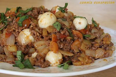 ground beef, potatoes, onions, garlic and tomatoes cooked a la menudo and garnished with hard-boiled quail eggs