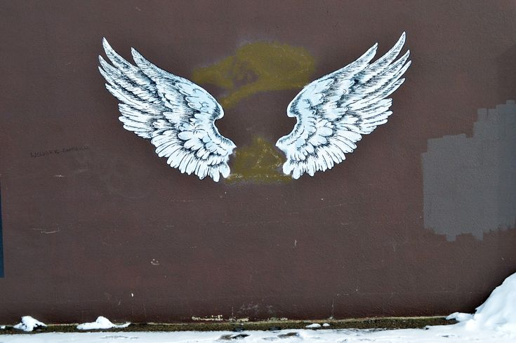 Angel Wings hand painted by The SignSmith on the side of his shop, 2016, Saskatoon SK