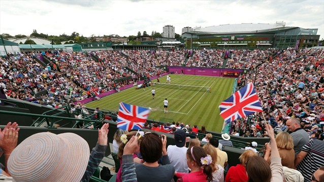 Fans cheer as Andy Murray and Jamie Murray of Great Britain play against Alexander Peya and Jurgen Melzer of Austria during their men's Doubles Tennis match on Day 1 of the London 2012 Olympic Games at Wimbledon.