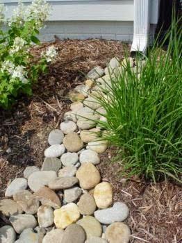 Garden Therapy: Wonderful Garden Tricks! river rock under downspout