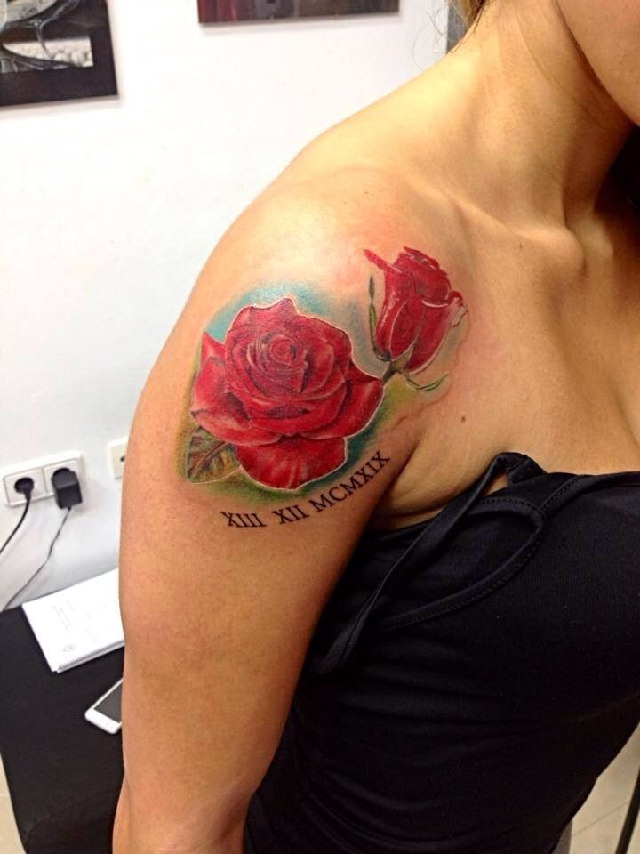 Rose on upper shoulder tattoo