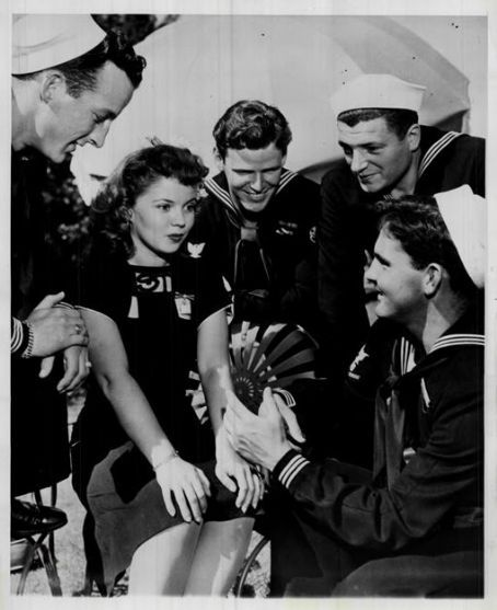 Shirley Temple entertaining servicemen. Circa WWII.
